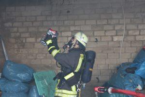 a fireman using thermal camera